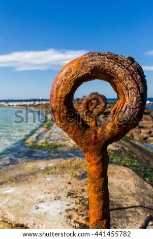 Looking through the fence at the canoe pool at Newcastle Ocean Baths, NSW Australia - stock photo
