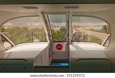 Looking through the windows at a major, metropolitan city center, from the interior of a monorail mass transit car. - stock photo