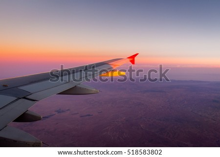 Looking through window aircraft during flight in wing with top view