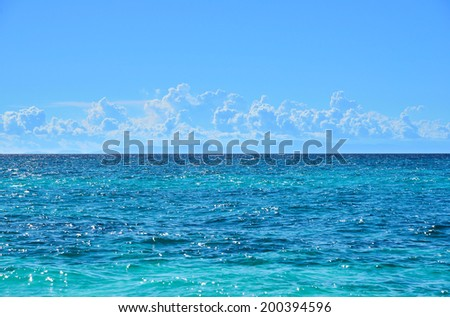 Looking to the horizon from the sea - stock photo