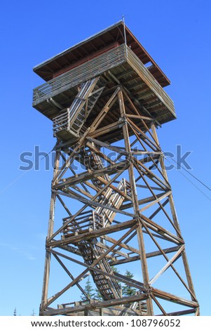 Looking to the top of a forest fire lookout - stock photo