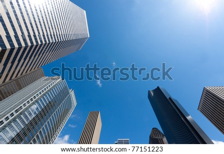 Looking up at a group of modern office buildings - stock photo