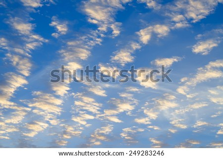 Looking Up at Blue Sky with Rows of White Clouds in Full Frame Scenic Background Image - stock photo