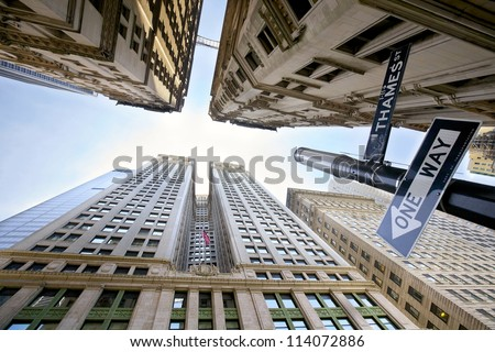 Looking up at Broadway's skyscrapers in Lower Manhattan, New York City - stock photo