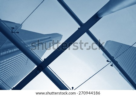 Looking up at business buildings through a glass roof - stock photo
