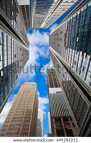 Looking up at modern city skyscraper buildings backgrounds