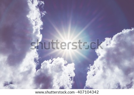 Looking up at Nice blue sky with sun beam and halo with cloudy,Vintage filter. - stock photo