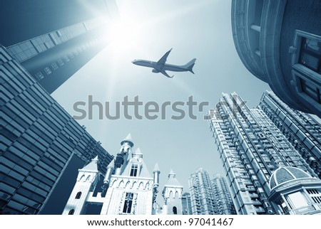 Looking up at skyscrapers by daylight - stock photo
