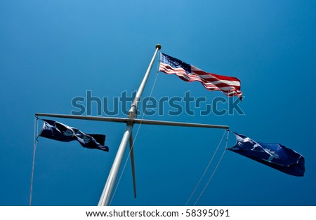 Looking up at the American Flag, the South Carolina State Flag and the Charleston Flag. - stock photo