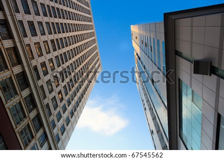 Looking up at the architecture of Skyscrapers with blue sky background in a  modern city . - stock photo