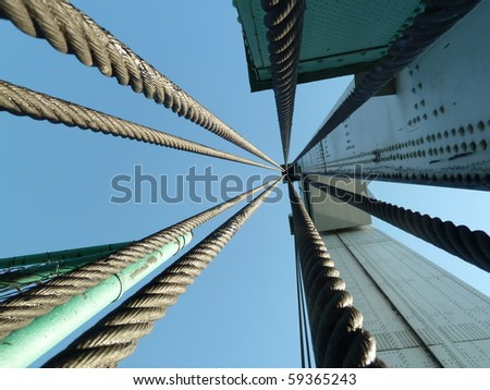 looking up at the cables of the Ward Island Bridge in Manhattan NYC - stock photo