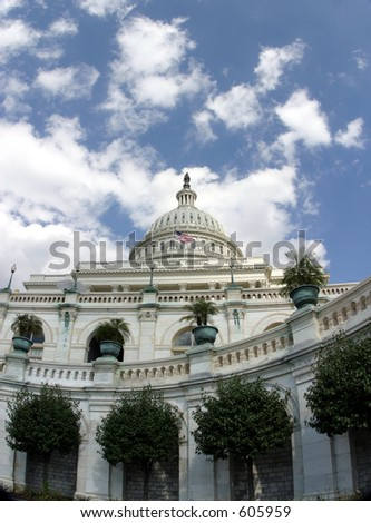 Looking up at the U.S. Capitol, with flag flying. - stock photo