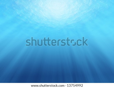 Looking up from under water, with sunrays streaming through water surface - stock photo
