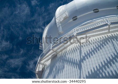 Looking up on the Canada-France-Hawaii Observatory atop the Mauna Kea volcano in Hawaii Big Island. - stock photo