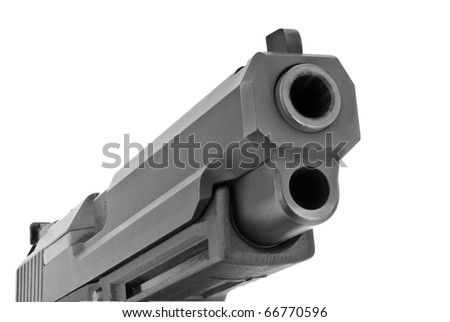 Looking up the barrel of a large 9mm automatic pistol - stock photo