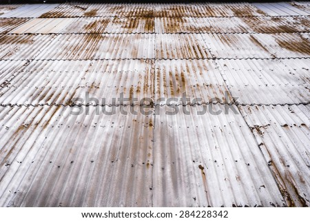 Looking up the exterior of a rusty corrugated grain elevator. - stock photo
