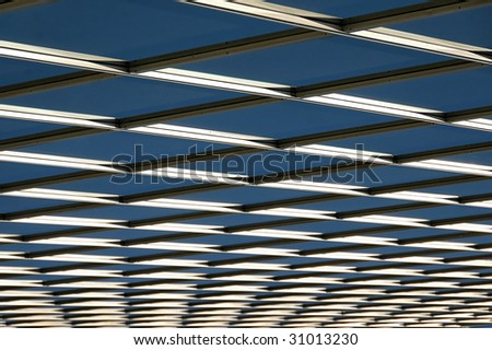 Looking up the glass partitions on a high rise office building - stock photo
