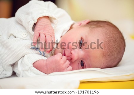 looking with openet eyes newborn baby in the hospital - the first hours of the new life - stock photo