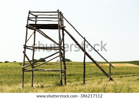 Lookout tower in the sunny field