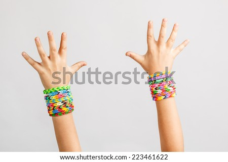Loom bracelets on a young kid hand - stock photo