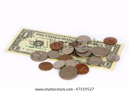 Loose change on one dollar bill - stock photo