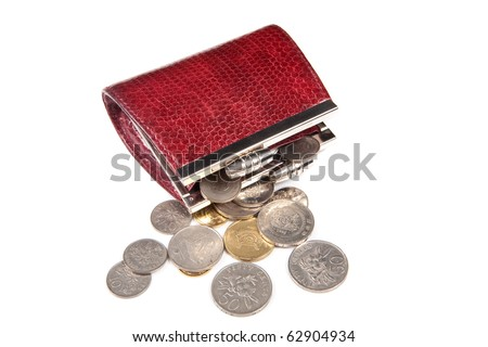 Loose change scattered out from red purse - stock photo