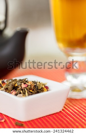 Loose leaf tea, tea pot and cup. Shallow depth of field - stock photo