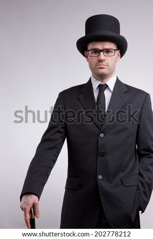lord black nerd with a top hat and a cane - stock photo