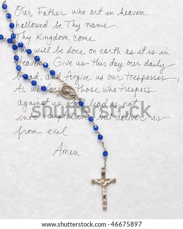 Lord's prayer with rosary beads - stock photo