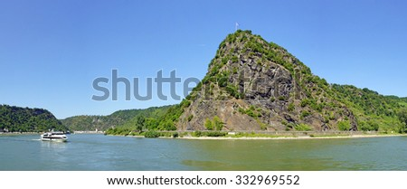 Loreley Rock at the Rhine River in Germany - Panorama Photo with the City St. Goar in the background, region Rhineland-Palatinate, Central Europe - stock photo