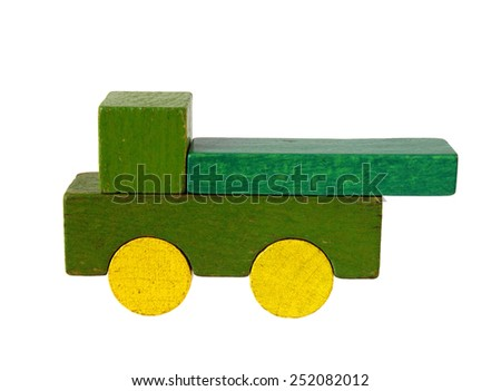 Lorry of wooden blocks, traditional toy on white background - stock photo