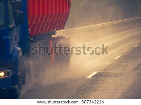 lorry on highway-delivery of goods in bad weather threat. heavy-duty truck on a wet road