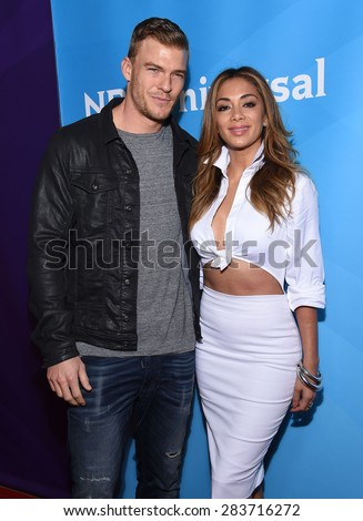 LOS ANGELES - APR 02:  Alan Ritchson & Nicole Scherzinger arrives to the NBCUniversal's Summer Press Day 2015  on April 02, 2015 in Hollywood, CA                 - stock photo