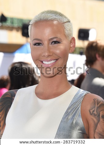 LOS ANGELES - APR 12:  Amber Rose arrives to the MTV Movie Awards 2015  on April 12, 2015 in Hollywood, CA                 - stock photo