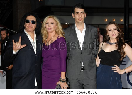 LOS ANGELES - APR 10 - Gene Simmons, Shannon Tweed, son Nick and daughter Sophie arrives at the Oblivion American Premiere on April 10, 2013 in Los Angeles, CA              - stock photo