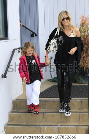 LOS ANGELES - APR 14: Heidi Klum takes her kids to karate lessons on April 14, 2012 in Los Angeles, California - stock photo