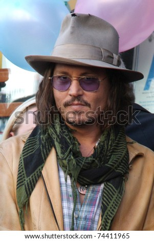 LOS ANGELES - APR 1:  Johnny Depp  at the Penelope Cruz Hollywood Walk of Fame Ceremony at El Capitan Theater on April 1, 2011 in Los Angeles, CA - stock photo