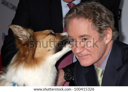 "LOS ANGELES - APR 17:  Kevin Kline with Kasey (the dog was Freeway in the movie) arrives at the ""Darling Companion"" Premiere at Egyptian Theater on April 17, 2012 in Los Angeles, CA"