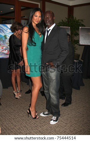 LOS ANGELES - APR 15:  Kimora Lee and Djimon Hounsou attending the 2011 Toyota Grand Prix Charity Ball at Westin Long Beach on April 15, 2011 in Long Beach, CA. - stock photo