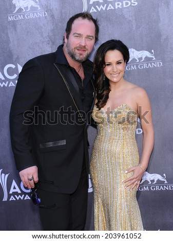 LOS ANGELES - APR 06:  Lee Brice & Sara Reeveley arrives to the 49th Annual Academy of Country Music Awards   on April 06, 2014 in Las Vegas, NV.                 - stock photo