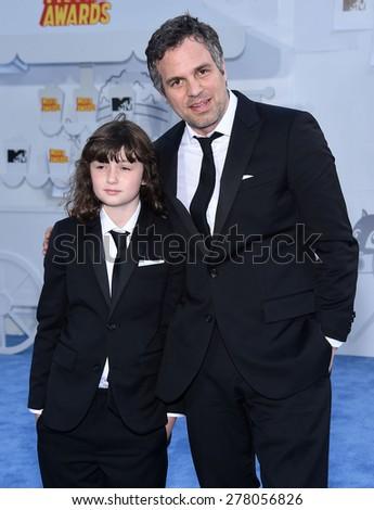 LOS ANGELES - APR 12:  Mark Ruffalo & Bella Ruffalo arrives to the MTV Movie Awards 2015  on April 12, 2015 in Hollywood, CA                 - stock photo