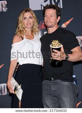 LOS ANGELES - APR 13:  Mark Wahlberg & Rhea Durham in the 2014 MTV Movie Awards - Press Room  on April 13, 2014 in Los Angeles, CA.                 - stock photo