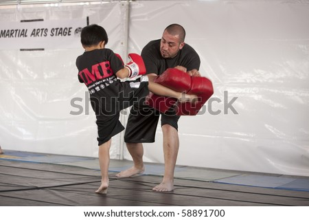 LOS ANGELES - APRIL 5:  Members of Torrance's IMB Academy demonstrate Thai Kickboxing at the Little Tokyo Cherry Blossom Festival in Los Angeles on April 5th, 2009. - stock photo