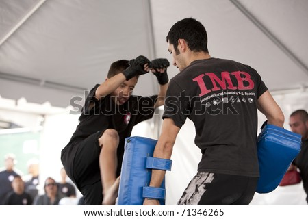 LOS ANGELES - APRIL 5:  Members of Torrance's IMB Academy demonstrate Thai Kickboxing at the Little Tokyo Cherry Blossom Festival on April 5th, 2009 in Los Angeles.