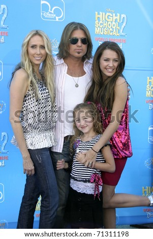 "LOS ANGELES - AUG 14:  Billy Ray & Miley Cyrus, with family arrive at the ""High School Musical 2"" Premiere at AMC Theaters - Downtown Disney on August 14, 2007 in Los Angeles, CA - stock photo"