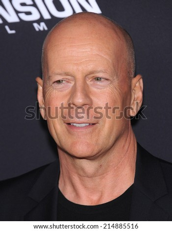 """LOS ANGELES - AUG 19:  Bruce Willis arrives to the """"Sin City: A Dame To Kill For"""" Los Angeles Premiere  on August 19, 2014 in Hollywood, CA                 - stock photo"""