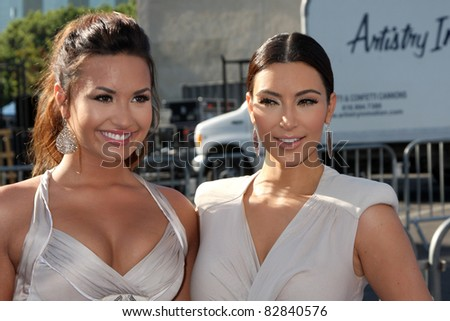 LOS ANGELES - AUG 14:  Demi Lovato, Kim Kardashian arriving at the 2011 VH1 Do Something Awards at Hollywood Palladium on August 14, 2011 in Los Angeles, CA - stock photo