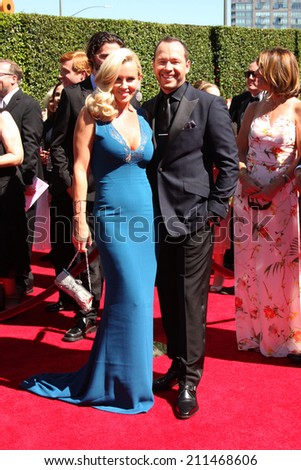 LOS ANGELES - AUG 16:  Jenny McCarthy, Donnie Wahlberg at the 2014 Creative Emmy Awards - Arrivals at Nokia Theater on August 16, 2014 in Los Angeles, CA - stock photo