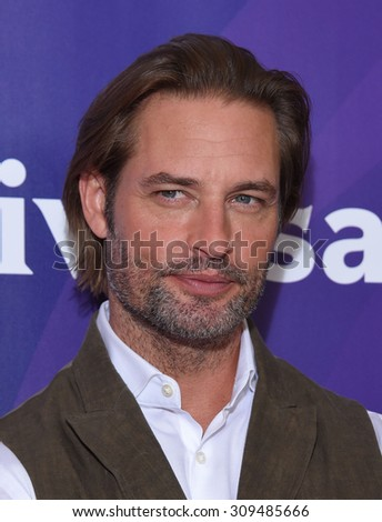 LOS ANGELES - AUG 12:  Josh Holloway arrives to the arrives to the Summer 2015 TCA's - NBCUniversal  on August 12, 2015 in Beverly Hills, CA                 - stock photo