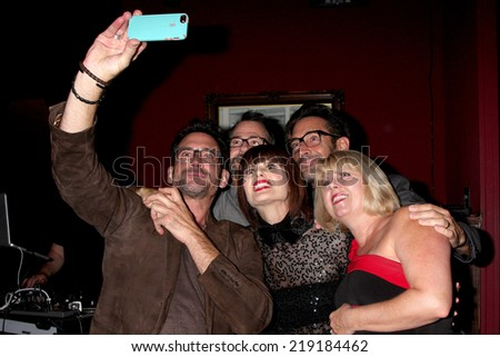 LOS ANGELES - AUG 19:  Lawrence Zarian, Carrie Genzel, Gregory Zarian, guests at the Carrie Genzel Birthday Party at Next Door Lounge on August 19, 2014 in Los Angeles, CA - stock photo